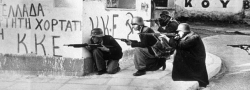 Greek-communist ELAS revolutionaries in Athens, wearing captured German helmets. On the walls is written KKE, the Greek Communist party.